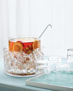 Punch Bowl Ice Bath Instead of watering down your drink with ice cubes that are destined to melt, give the entire vessel its own ice bucket. Slip one glass container inside another (we found these multipurpose cylinders at a floral-supply shop, jamaligarden.com), and put the ice between them.