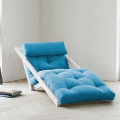 Fresh Futon: Figo Blue With White Frame Constructed as a chaise lounge that spreads flat into a comfy sleep surface for guests.