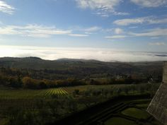 Tuscany skies - foggy hills under a sky with few high & medium clouds (near Gaiole in C., Firenze)