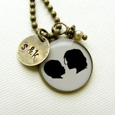 Mother's Day Sale Item  Silhouette Necklace by craftedbykerstin, $60.00 you send her the silhouettes of your kids and she puts them in the necklace... I need one of these.