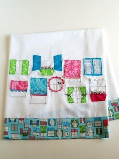 Windows Towel (Need: White fabric, or purchased dishtowel  • Fabric for bottom border – 1/2 yard  • Fabric scraps  • Trim scraps  – rick rack, tiny pompoms, etc.  • Embroidery floss for window boxes)