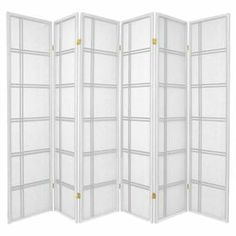 "Add visual interest to your master suite or section off a large space with this eye-catching room divider, showcasing a shoji screen design and white finish.  Product: Room divider Construction Material: WoodColor: WhiteFeatures:  Six panelsShoji screen designFive-way hinges allow you to bend panel in either direction Dimensions: 70"" H x 84"" W"