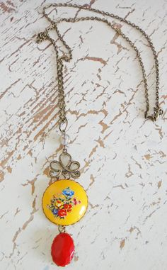 Yellow and red pendant with floral design