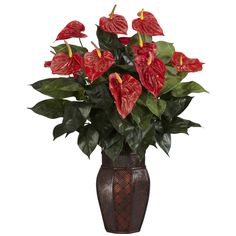 """Anthurium w/Vase Silk Plant - If you need a floral arrangement that will make people stop and say """"Wow"""", then this is the display that you want. Why, the bright colors alone are enough to bring a smile to anyone's face. That's nothing to say of the delicate, yet lush leaf patterns that play across this lovely setting. Standing at 30"""" tall in its included vase, this will certainly be a high point of any room. Number of Trunks: NA Number of Flowers: NA Number of Leaves: NA Pot Size: W: 7 in, H"""