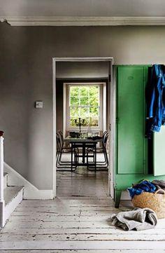 grey walls, green cupboard, rustic white floor