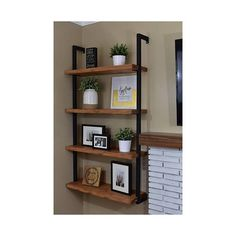 You Found It!!! **HEAVY DUTY** - Side Framed Floating Shelf Unit. This sleek sturdy design brings DIY Shelves to a new level! Made from 1 1/4 square steel tubing to provide high weight capacity. Super easy installation, wood not included. These particular shelves are spaced 16 apart.