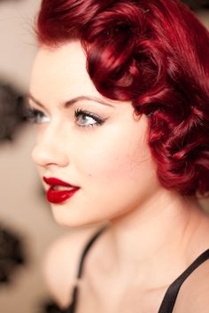 love the hair- style and color. and those bright red lips.