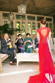 Gorgeous red dress for chinese tea ceremony before wedding Jun and Zhao's Hawaiian Wedding - Photo by Anna Kim Photography