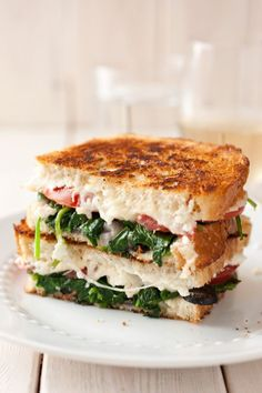 Mediterranean Grilled Cheese with feta and mozzarella, along with all the fresh flavors of a Mediterranean salad (tomatoes, sliced black olives, red onion, fresh basil, and garlic)