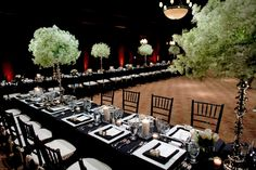 Black tablecloths with white candle wedding centerpiece decor, photo by John and Joseph Photography