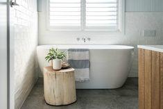 kyal and kara renovation bathroom with log side table beside bath Boho Bathroom, Laundry In Bathroom, Bathroom Renos, Bathroom Colors, Bathroom Flooring, Bathroom Renovations, Bathroom Furniture, Bathroom Interior, Home Interior