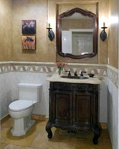 Tuscan Twist To A Track Home traditional-powder-room