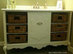 """I bought an old stereo cabinet for $32 at a thrift store. I took it apart, cut it to 48"""" wide, and put it back together. I added basket drawers and a recycled sink. We use it in the kids' bathroom."""