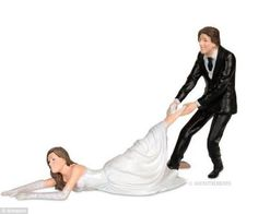 Are these the most inappropriate wedding cake toppers? Bizarre figurines that could send your guests running from the reception