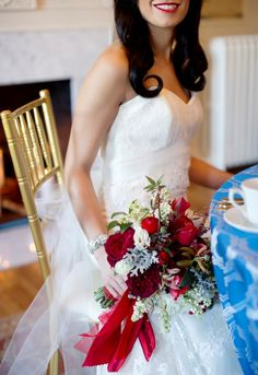 Valentine's Day inspiration shoot from Dogwood Events. Photography by Kristen Gardner Photography. Flowers by Holly Chapple Flowers. Dress from Fabulous Frocks of Alexandria. Suit from Christopher Schafer Clothiers. Beauty by Amie Decker Beauty. #Valentine #wedding #bride  #sweetheart #table #centerpiece #fireplace #red #blue #Virginia #bouquet #dress