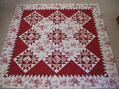 Pattern: Red Union Square  Book: The Simple Joys of Quilting by Joan Hanson and Mary Hickey  Fabric: red and white scraps from stash