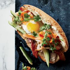 This riff on a classic Vietnamese sandwich features crispy, sweet-spiced bacon and a fried egg along with the traditional pâté and spicy vegetable pickles.