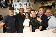 "Warner Bros. At Comic-Con International 2014  SAN DIEGO, CA - JULY 26: In this handout photo provided by Warner Bros, Stephen Amell, David Ramsey, Willa Holland, Paul Blackthorne, Colton Haynes and John Barrowman, with executive producer Marc Guggenheim of ""Arrow"" attend Comic-Con International 2014 on July 26, 2014 in San Diego, California.(Photo by Michael Yarish/Warner Bros. Entertainment Inc.)"