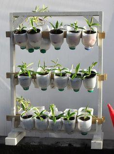 DIY Vertical Herb Garden From Plastic Milk Cartons