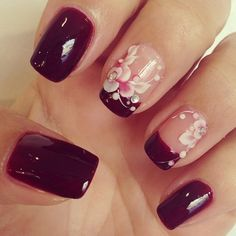 Beautiful deep blood red manicure with light flower detail! Such a elegant set of nails :)