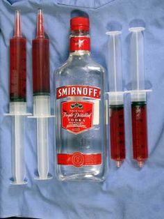 "Medical and lab themed props are another great way to make your Jell-O shots scarier. Use large syringes (without needles) to suck up your Jell-O mixture, and then chill as usual. A size somewhere between 30ml and 60ml will deliver a decent shot sized ""shot"". The 60ml catheter tip syringes we found were ideal and included a cap to put over the end – nice to keep the Jell-O from dripping."