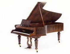 This is a Magnificent Grand Piano http://adjustablepianobench.net