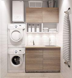 Decora la habitación de la lavadora y planchado con tonos pastel y líneas limpias.