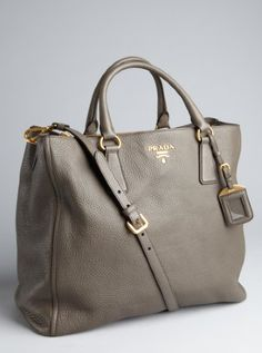 """Olivia has a """"go to"""" Prada...Here is a graphite leather convertible tote"""