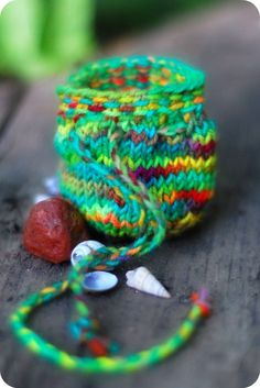 Free knitting pattern for Treasure Pouch - These easy pattern from The Sitting Tree is about 2″ tall. Great with multi-color yarn!