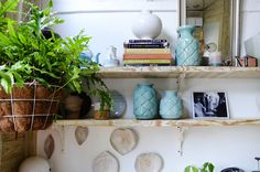 Unique accessories and ceramics on the guest bedroom shelves