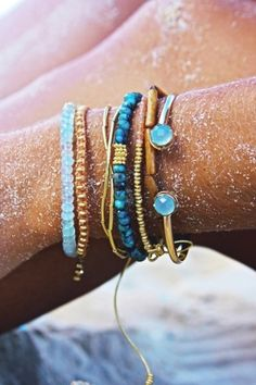 colored metallic and twine bracelets beachy