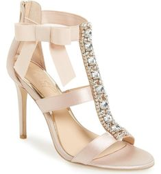 A wide, crystal-finished T-strap adds indulgent detail to a towering sandal finished with a flirty grosgrain bow. #weddingshoes