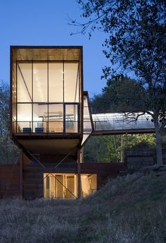 Labatory house, Omaha Nebraska.  Landscape is set for a stunning view. Bridges and stairs connect the disparate elements of the house.