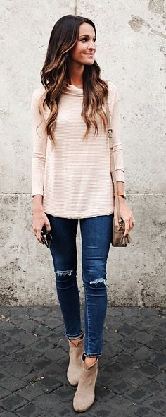#winter #outfits brown long-sleeve top and blue distress skinny jeans