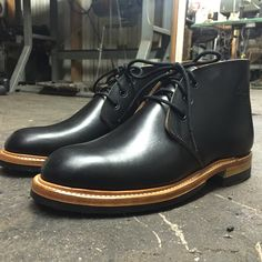 Role Club chukka boot. Black horsehide. Natural edge finish. Storm welt. Low block heel.