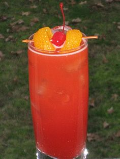 Octopussy (1 oz. DeKuyper Sour Apple 1 oz. Sloe Gin 1 oz. Amaretto .5 oz Triple Sec 1.5 oz Orange Juice 1.5 oz. Sweet & Sour mix Mandarine Orange slices and Cherry for garnish)