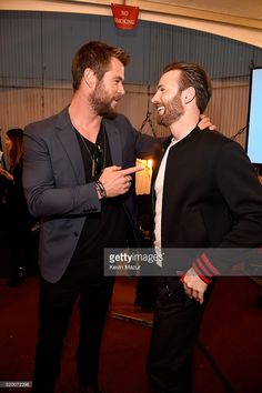 Actors Chris Hemsworth (L) and Chris Evans attend the 2016 MTV Movie Awards at Warner Bros. Studios on April 9, 2016 in Burbank, California. MTV Movie Awards airs April 10, 2016 at 8pm ET/PT.