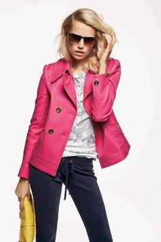pink jacket with yellow clutch