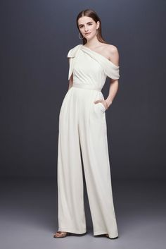 One-Shoulder Crepe Wedding Jumpsuit with Bow David's Bridal white jumpsuit wedding rehearsal dinner bridal shower jumpsuit Davids Bridal Dresses, Wedding Dresses, Wedding Outfits, Wedding Attire, Wedding Pantsuit, Boho Vintage, Wedding Jumpsuit, Courthouse Wedding, White Jumpsuit