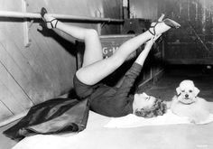 """""""Dutifully watched by Cliquot, Joan Crawford goes through extensive exercising in preparation for her role in 'Torch Song.'""""   That Joan was a trippy broad. #vintage #exercise #fitness #legs"""