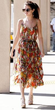 click to shop Selena Gomezs affordable Free People dress!