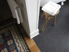 No threshold bathing area: Two pony walls on each side with the black hex tile connecting to the hardwood. Such a great way to design a no threshold bathing area and keep the hardwood seamless.