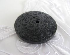 Large wooden carved button; vintage, painted black, two-hole, ± 3,5 cm