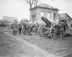 WWI, 22 Nov 1917; British soldiers examine two German field guns captured by the 11th Battalion, Essex Regiment, at Ribecourt. Battle of Cambrai. ©IWM (Q 6313)
