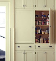10 Kitchen Pantry Ideas for Your Home - Town & Country Living pantry cabinet. LOVE LOVE LOVE - love the look, the storage & the color - for folk victorian kitchen in our new old house Kitchen Pantry Cabinets, Kitchen Redo, New Kitchen, Kitchen Remodel, Wall Pantry, Kitchen Ideas, Kitchen Floor, Pantry Cupboard, Pantry Storage