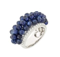 18K white gold ring with blue sapphire briolettes. (20.13ct) an diamond accents (1.07ct). Gold weight 9.37gm Size 6.5