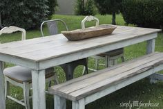 Very soft rustic finish. light wash weathered top and white distressed base. reclaimed wood bench to match.