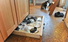 under kitchen cabinet storage - things like pizza pans, cupcake pans, cookie pans, pot lids! - what it looks like pulled out in full ... great use of lost space!