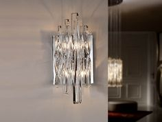 Wall lamp of 2 lights made of metal, bright chrome finish. High quality clear crystal drops, spiral shapes.
