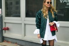 The Best Street Style from New York Fashion Week, not so classic shirt and bomber jacket, pop-up color purse  - excellent look. And dark green, white and red combination aren`t only for Christmas time.